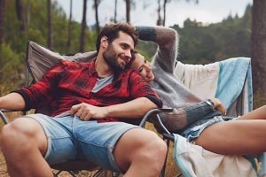 Loving young couple camping