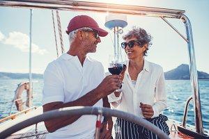Romantic senior couple having wine