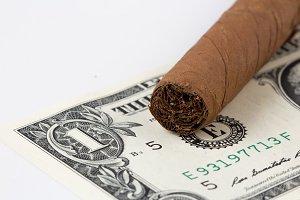 Dollar wasting money on cigar