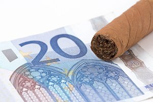 Euro Currency buying cigar