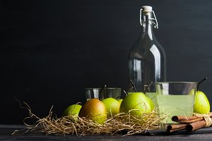 Fresh pears on the rustic background