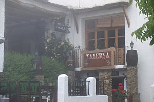 balcony of tavern on fog