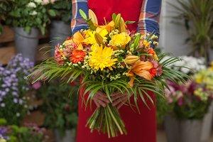 Florist holding flowers bouquet