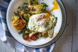 Fried egg yolk and potatoes