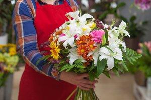 Florist holding flowers bunch