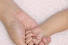 baby hand in mom palm