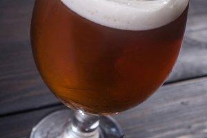 Amber ale on dark wood