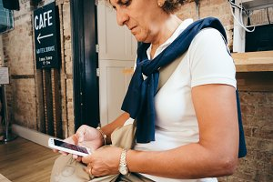 Woman with mobile in cafe