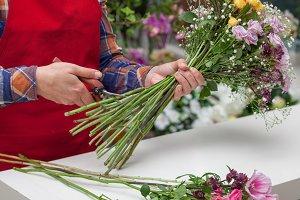 Florist cutting stems of flowers