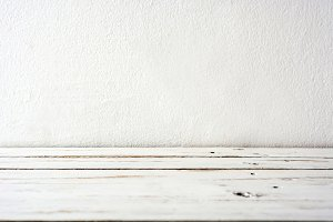 White wooden floor and white wall