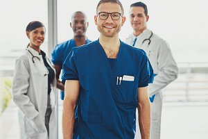Relaxed confident doctor leading medical team