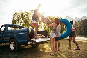 Young friends unloading pickup truck