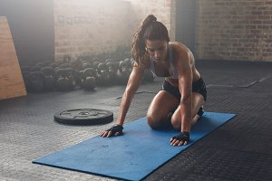 Muscular woman exercising