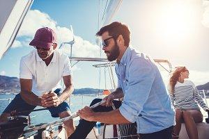 Men preparing to set sail on yacht