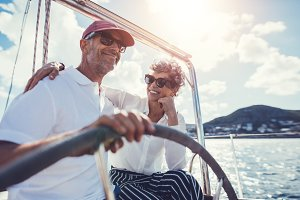 Senior couple having fun sailing