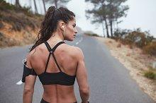 Muscular young runner standing