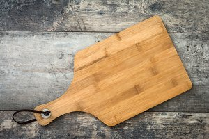 Cutting board on a wooden background