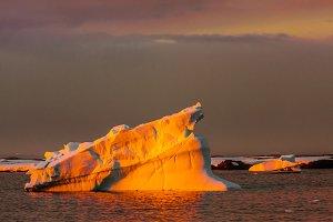 Orange antarctic iceberg