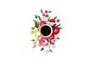 Coffee mug and floral composition