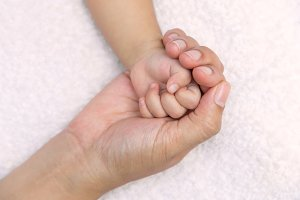 baby hand in mom palm.