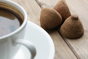cup of coffee and a chocolate truffles