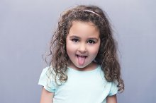 Girl showing tongue