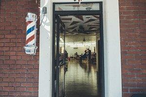 Guy Cutting Hair in a Barbershop