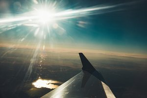 Sun Shining Over Wing of a Plane