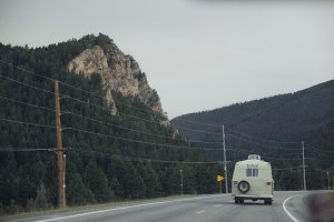RV Driving Through Canyon Pass
