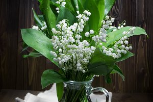 Lilies of the valley in glass jug