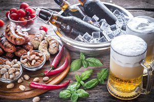 Grilled sausages with mugs of beer