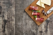 Spanish serrano ham on cutting board