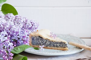 Poppy seed cake with lilac flowers