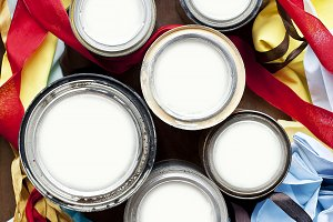 Textiles and cans of paint