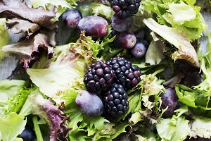 Green salad with berries and grapes