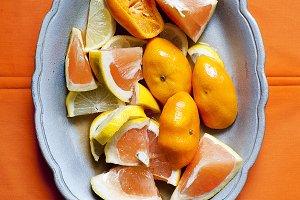 Citrus fruits on orange background