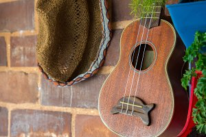 guitar and hat decoration on brick