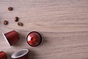 Three capsules on wooden table
