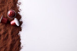 Capsules and ground coffee top