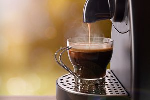 Machine making coffee vertical