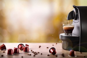 Espresso machine making coffee front