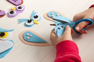Child cutting felt to make a craft