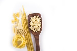 dry pastas with wooden spoon