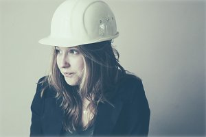 Young woman with hard hat