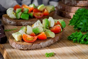 Avocado tomato salad on toast