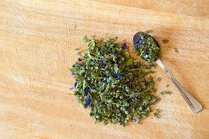 Mallow herbal tea spoon on wood