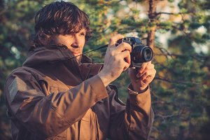 Man with retro photo camera outdoor