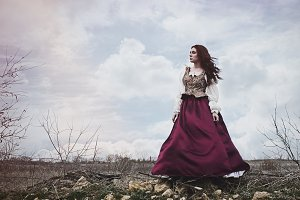 Renaissance Woman Stands on Hill
