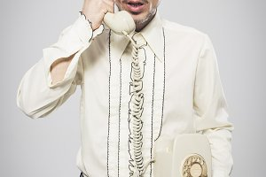 Portrait of a man talking on classic phone