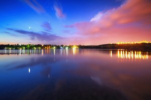 Colorful night landscape on the lake
